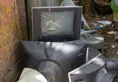 Dumpster with pile of televisions and VCRs being junked in Mokena